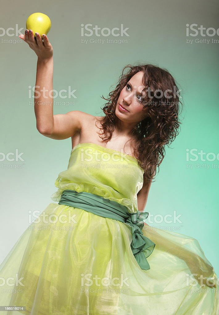 Beautiful spring woman with apple. Green concept royalty-free stock photo