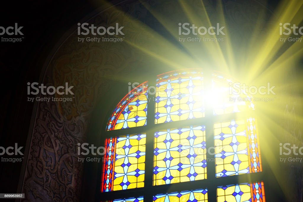 Beautiful stained glass window with sunlight stock photo