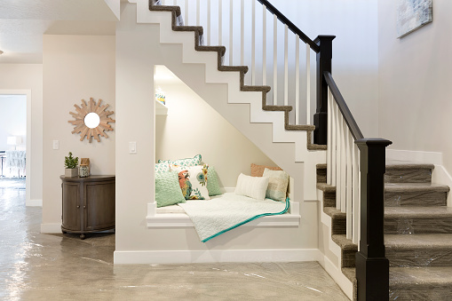 Reading nook underneath stairs with perfect ambience