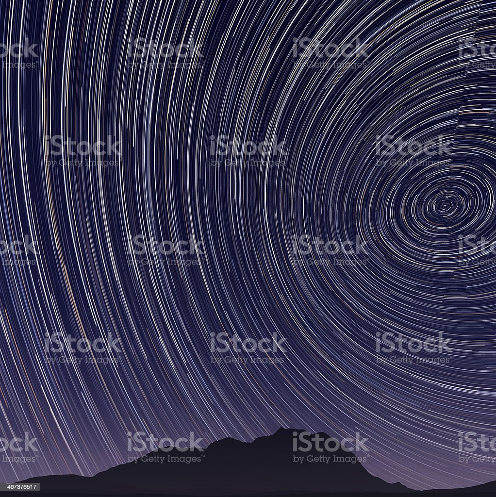 Beautiful star trail image during at night stock photo