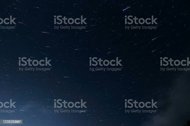 Photo of Beautiful Star Trails on a Clear Blue Night Sky, Skyscape, 5K