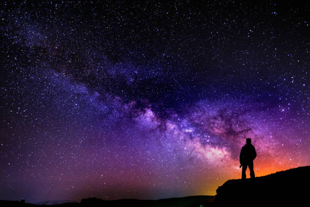 Beautiful starry night, man silhouette with a camera looking at the Milky Way galaxy. Beautiful starry night, man silhouette with a camera looking at the Milky Way galaxy. armenia country stock pictures, royalty-free photos & images