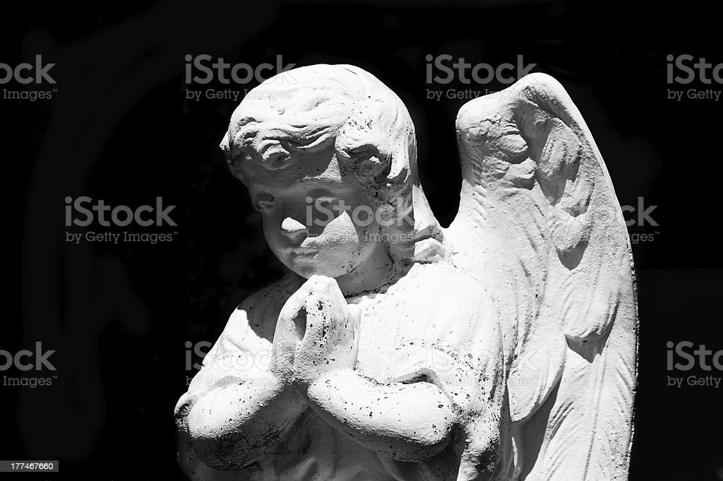 Beautiful statue of the angel praying royalty-free stock photo