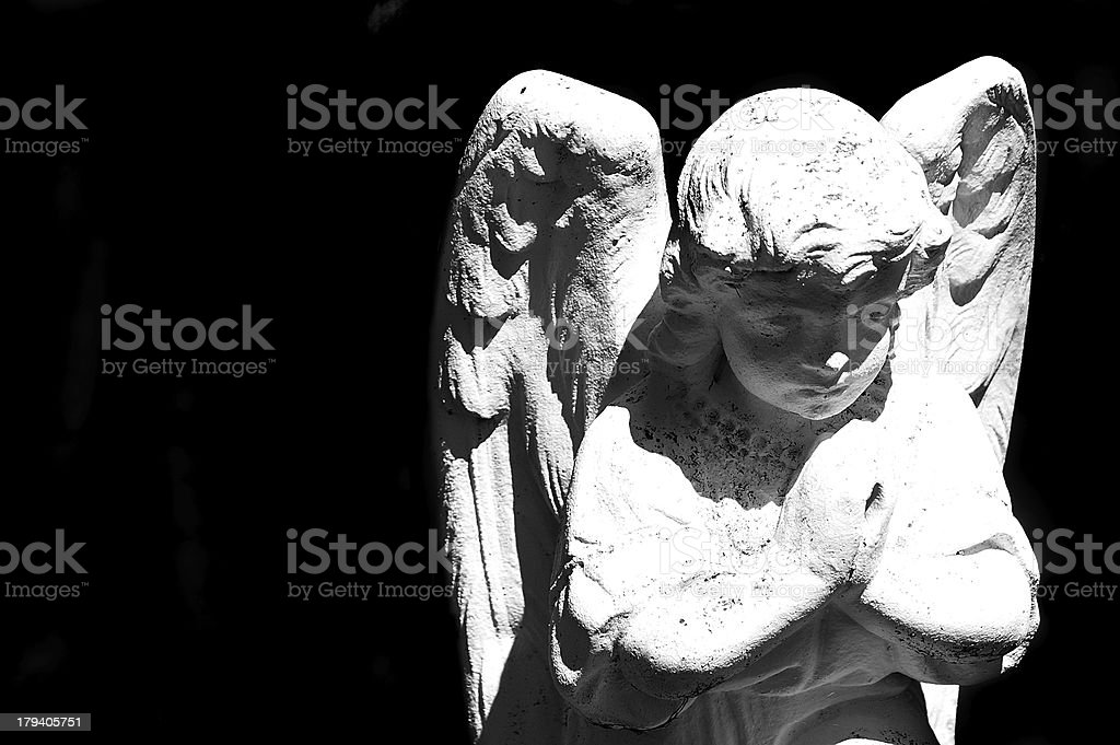 Beautiful statue of the angel praying royalty-free stock photo