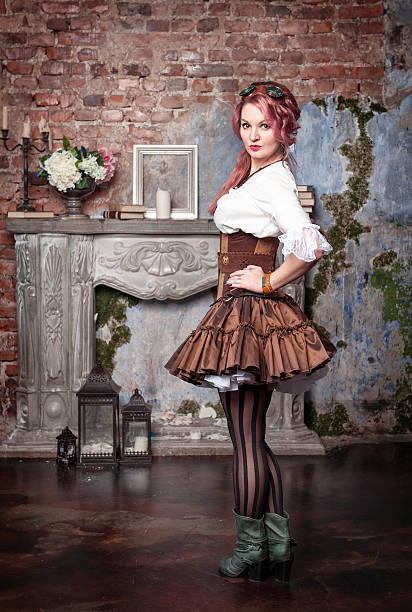 beautiful steampunk woman posing - steampunk fashion stock photos and pictures
