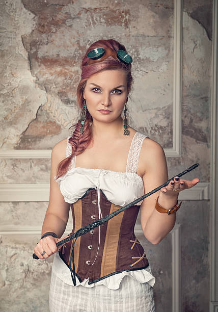 Beautiful steampunk woman with whip stock photo