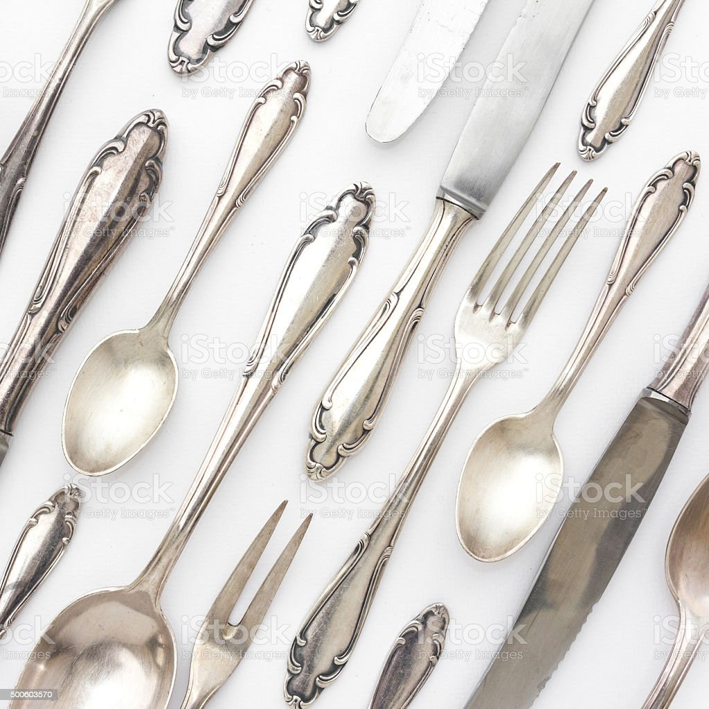 beautiful sterling cutlery collection on white background stock photo