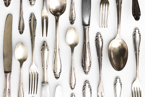beautiful sterling cutlery set on white background stock photo