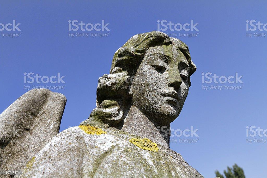 Beautiful stone angel with caring regard royalty-free stock photo