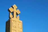 Beautiful Stone Carving Cross Pillar on Vivid Blue Sky, Holy Trinity Cathedral of Tbilisi, Historic Place in Georgia