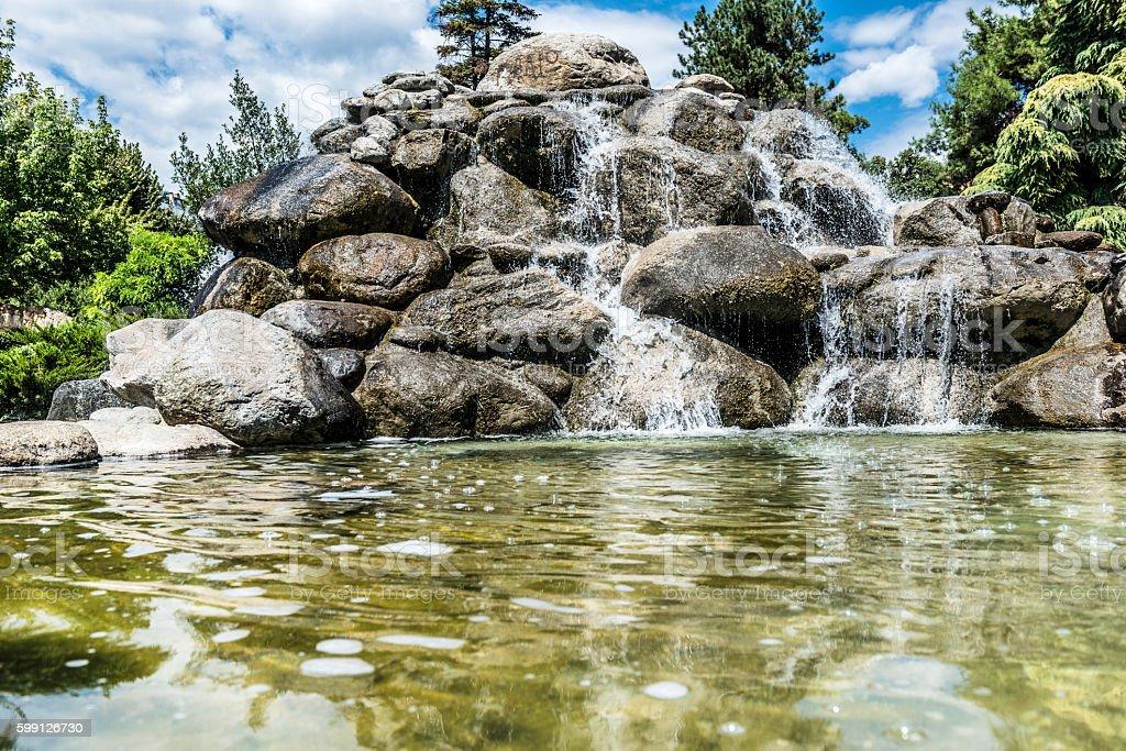 Beautiful stone watefall fountain stock photo