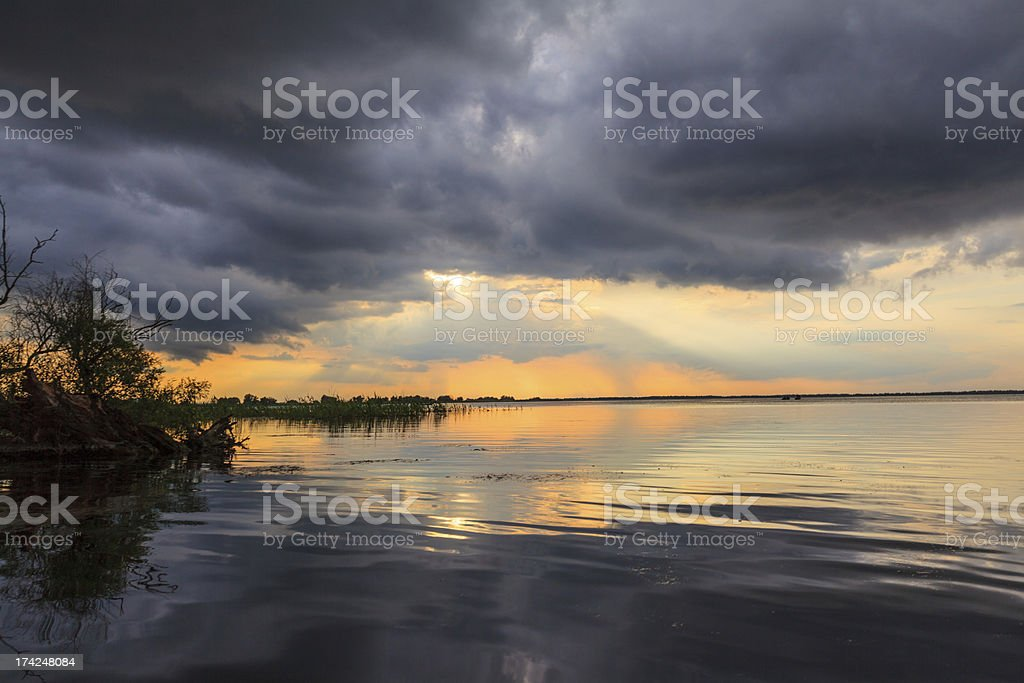 Beautiful storm clouds over lake in spring royalty-free stock photo