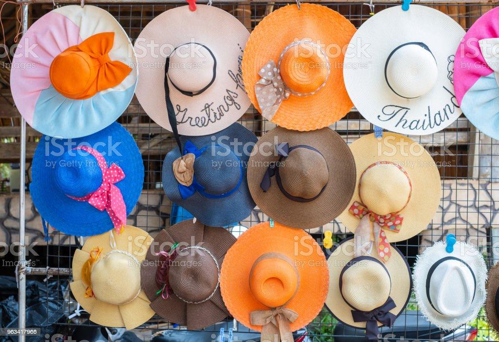 Beautiful straw hat fashion of women for summer trip on the beach in Thailand - Zbiór zdjęć royalty-free (Akcesorium osobiste)