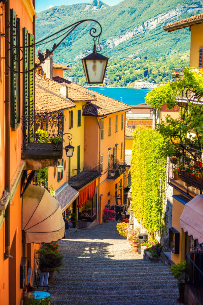 beautiful street in bellagio city in italy - lake como stock photos and pictures