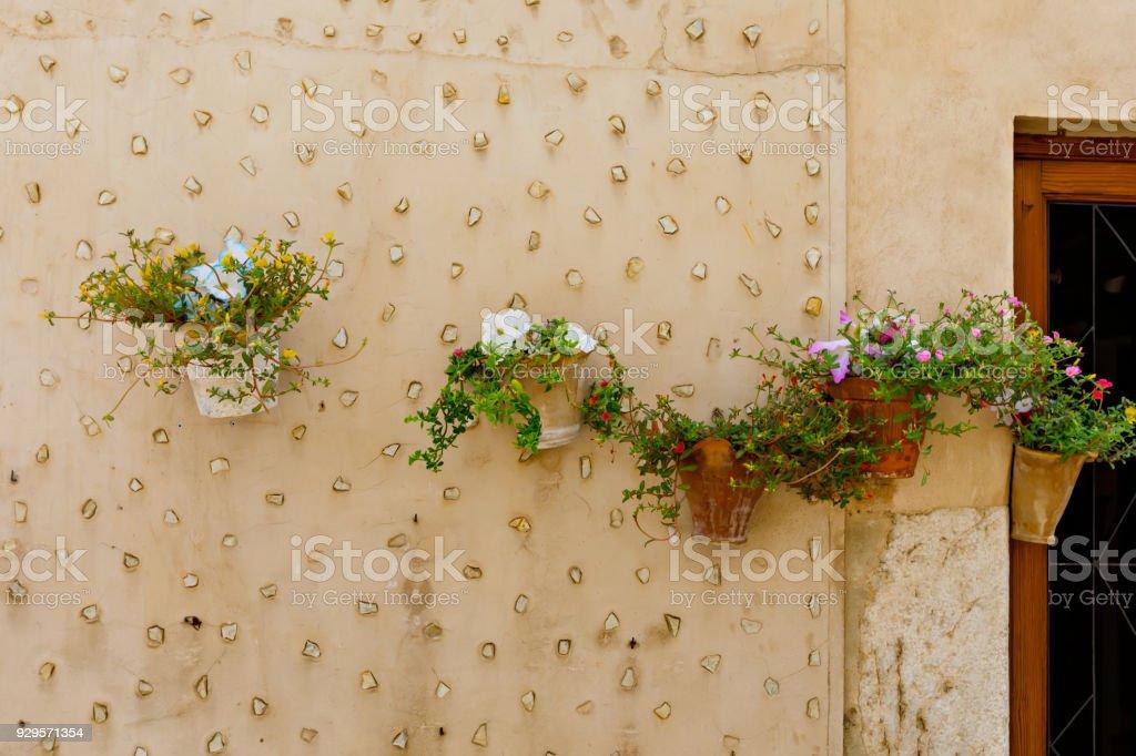 Beautiful street in Valldemossa with traditional flower decoration, famous old mediterranean village of Majorca. Balearic island Mallorca, Spain stock photo