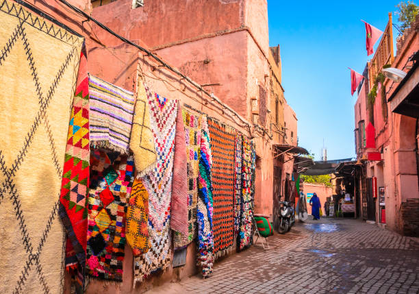 beautiful street of old medina in marrakech, morocco - north africa stock photos and pictures
