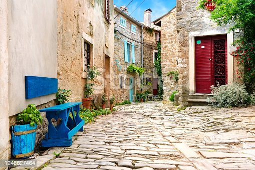istock Beautiful street scene with ancient houses in Groznjan town on a sunny day, Croatia. 1246627464