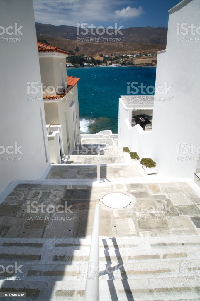beautiful street view at Chora, the capital of Andros island in Greece stock photo