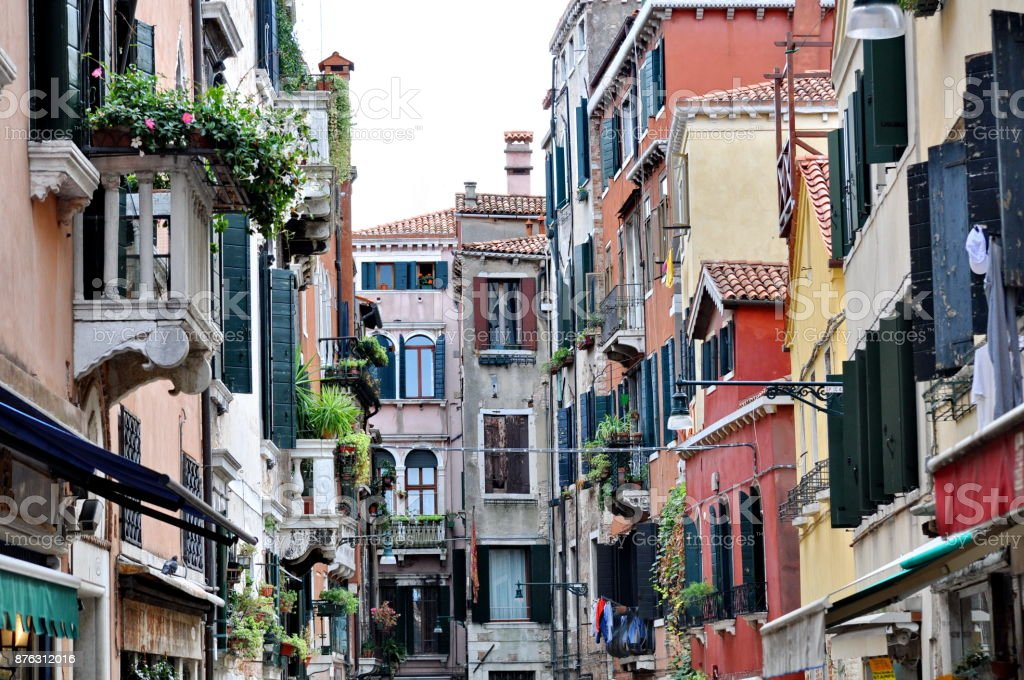 Beautiful street with colorful buildings in Venice, Italy stock photo