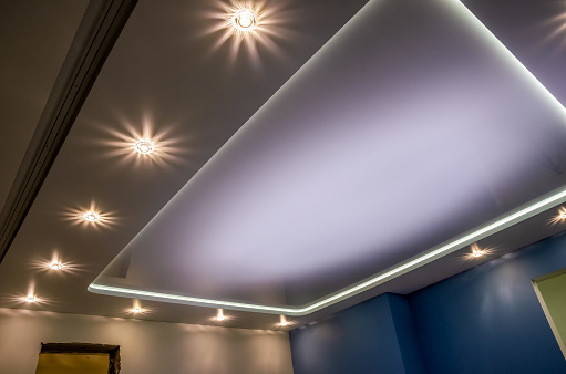 Beautiful stretch ceiling with led lighting, spotlights around the perimeter.