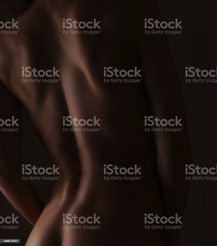 Beautiful strong woman back. Closeup art portrait on dark stock photo
