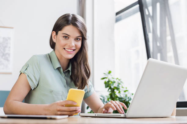 Beautiful student girl or business woman using laptop stock photo