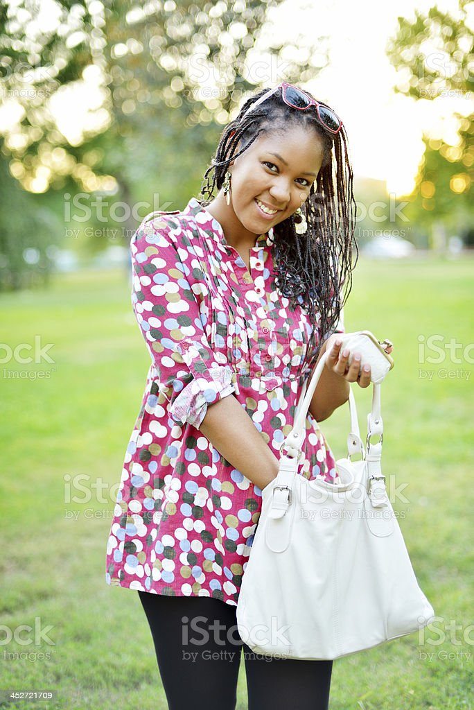 Beautiful student in a park royalty-free stock photo
