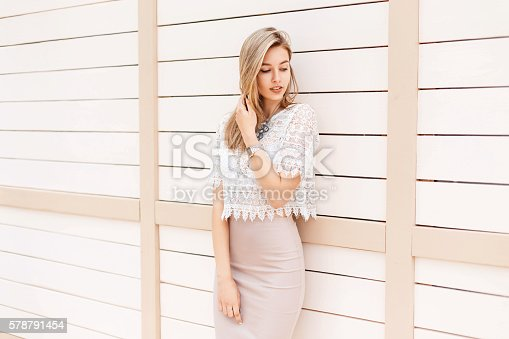 istock Beautiful stylish girl in vintage lace blouse with ornament posing 578791454