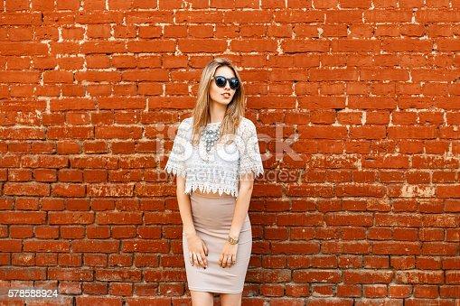 578791454istockphoto Beautiful stylish modern woman in white lace vintage blouse, skirt 578588924
