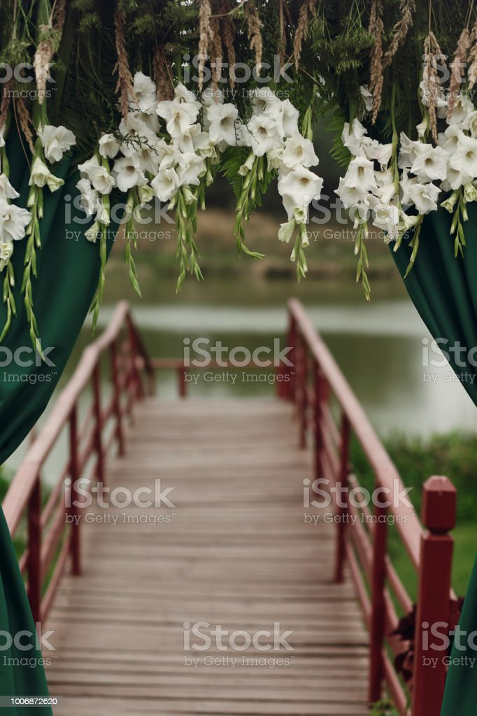 Beautiful Stylish Wedding Aisle Pathway With White Floral Garland