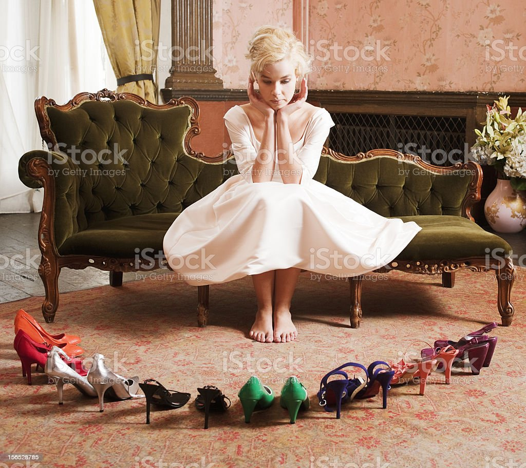 Beautiful, Stylish Woman Choosing Shoes stock photo