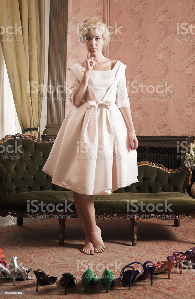 Beautiful, Stylish Woman Choosing Shoes royalty-free stock photo