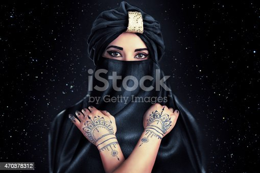 istock beautiful stylish woman in oriental style in turban 470378312