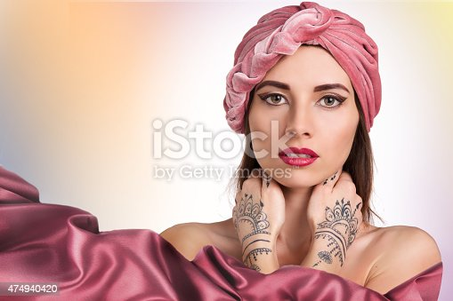 istock beautiful stylish woman in oriental style in turban 474940420