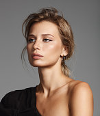 Portrait of beautiful fashionable woman wearing black top