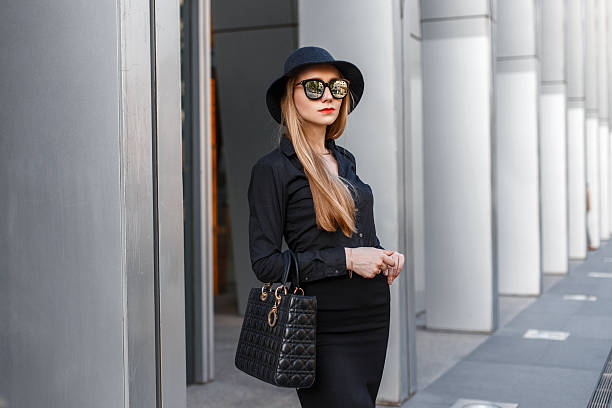 beautiful stylish young business woman in a hat and sunglasses - rock make up stock-fotos und bilder