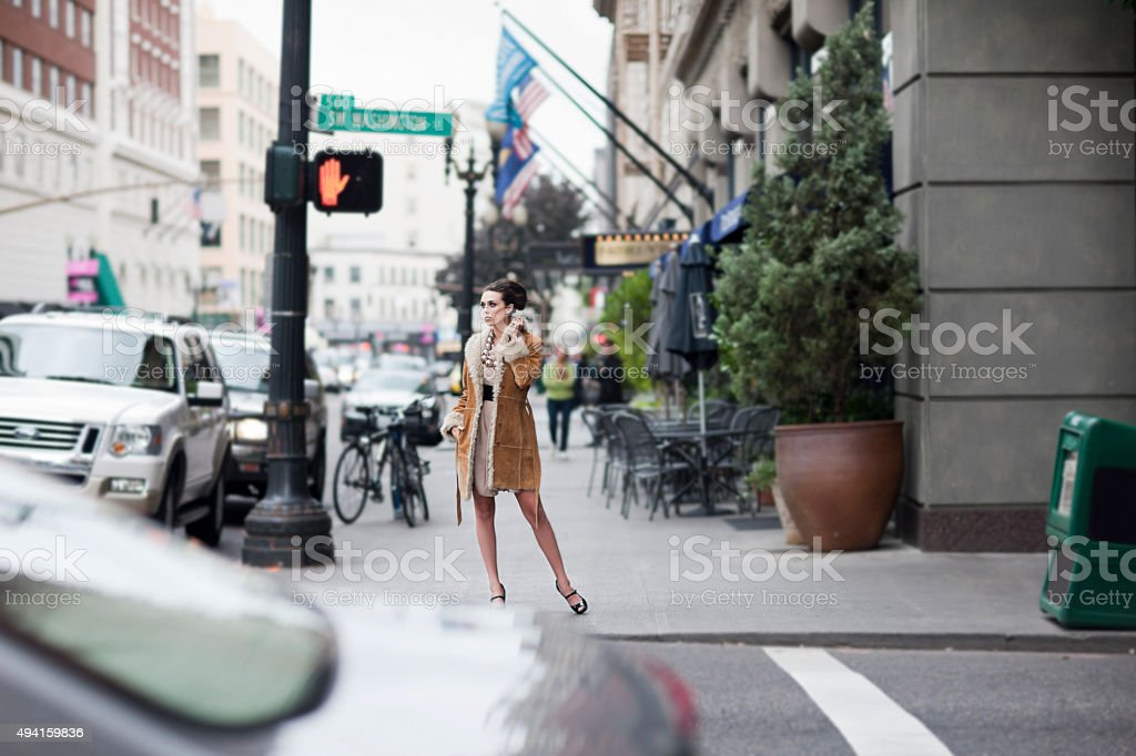 Beautiful Stylish Young Woman Fashion Model on Busy Downtown Street stock photo