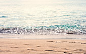 Beautiful summer season specific photograph. Calm beach/shore waves. Rich blue/turquoise marine/ocean colors. Lovely lights and summer colors. Marine and ocean environment in summer.