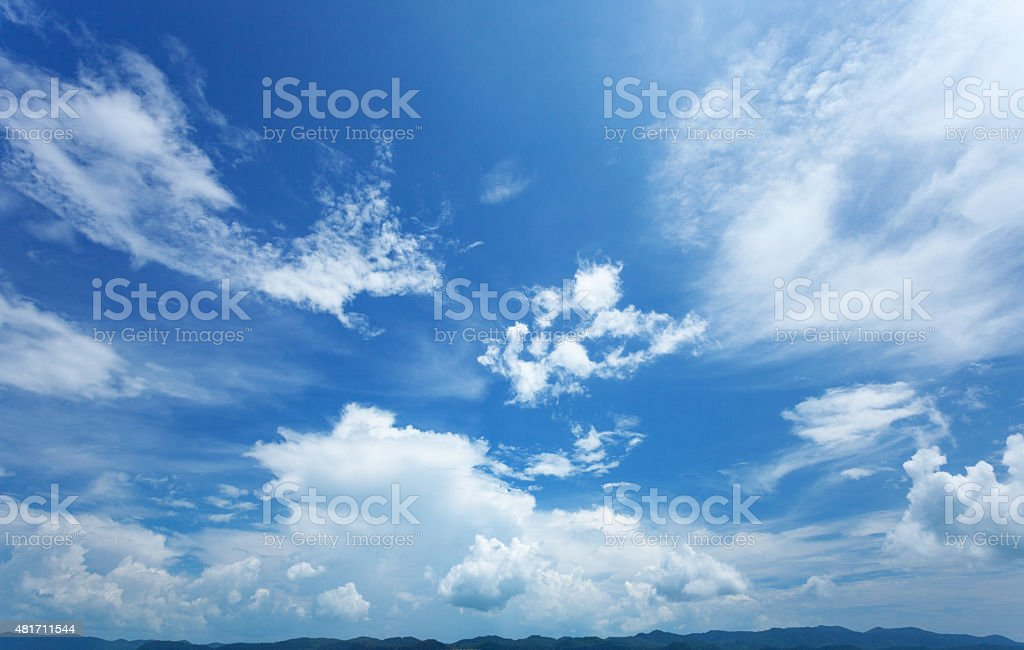 Beautiful summer sky, and silhouettes of mountains on horizon stock photo