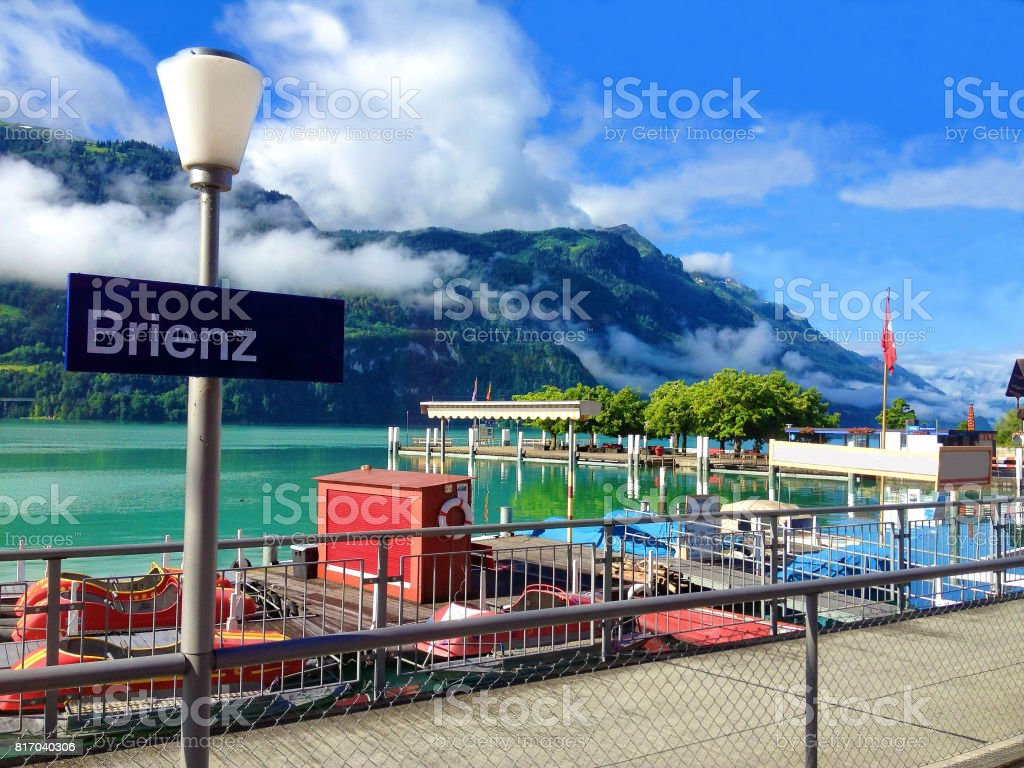 Beautiful summer view of Brienz village and harbor on the northern shore of idyllic colorful turquoise Lake Brienz, Brienzersee, in Interlaken-Oberhasli administrative district of the canton of Bern, Bernese Oberland, Switzerland, Europe. stock photo