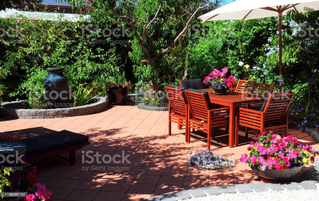 Beautiful and lush summertime Mediterranean style courtyard garden...