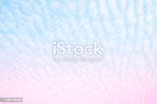 istock Beautiful Sun and Cloud Abstract with a Pastel Color. Fantasy Gradient Blurred Blue and Pink Sky Background. Soft Heaven Bright Cloudy Summer Day. Open View Cloudscape Nature, Texture for Freedom. 1138745403
