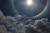 Beautiful sun halo with the blue sky and half spectrum