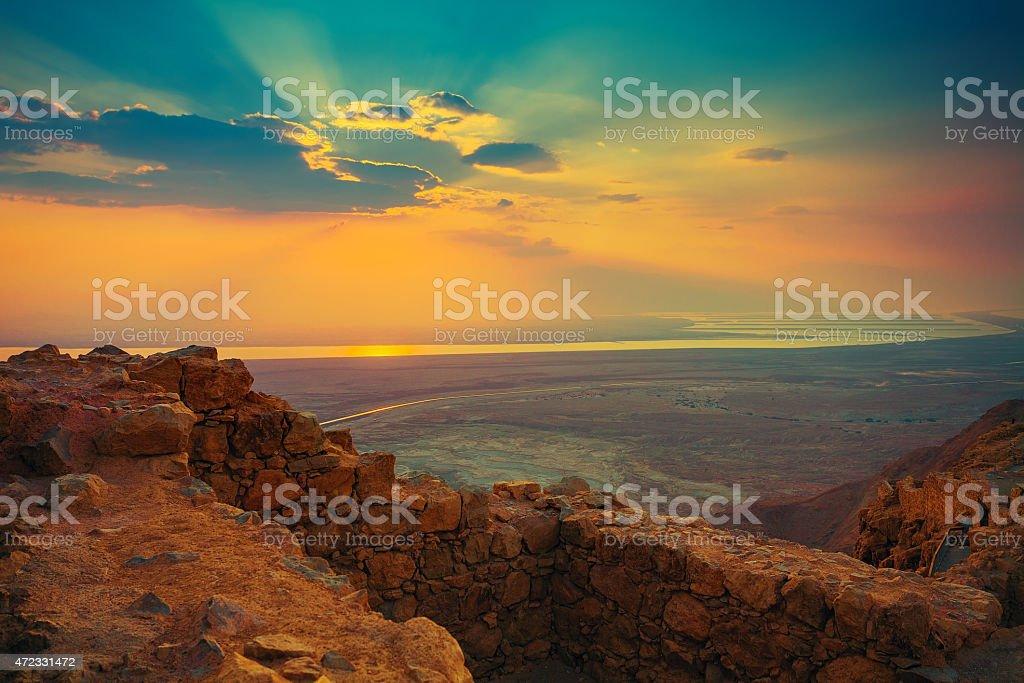 Beautiful sun rising over Masada fortress stock photo