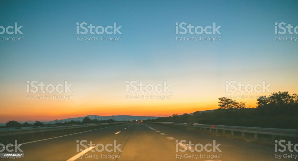 Beautiful Sun Rising Sky With Asphalt Highways Road In Rural Scene