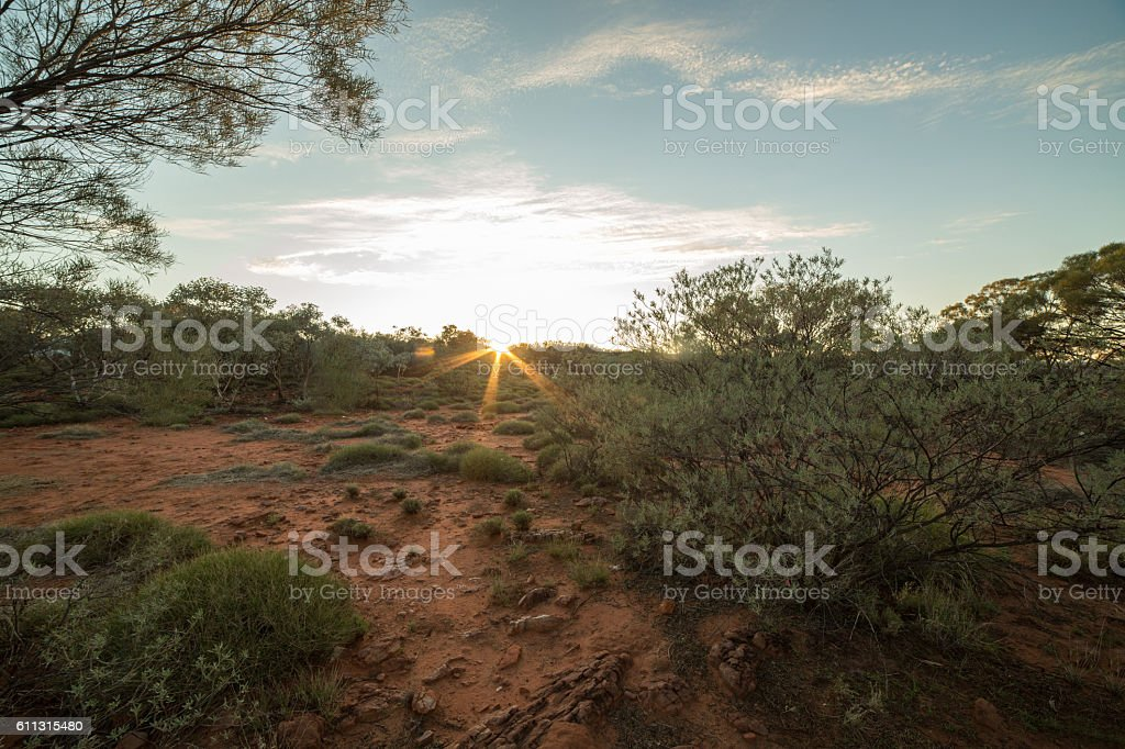 Beautiful sun setting down in the Australian outback stock photo
