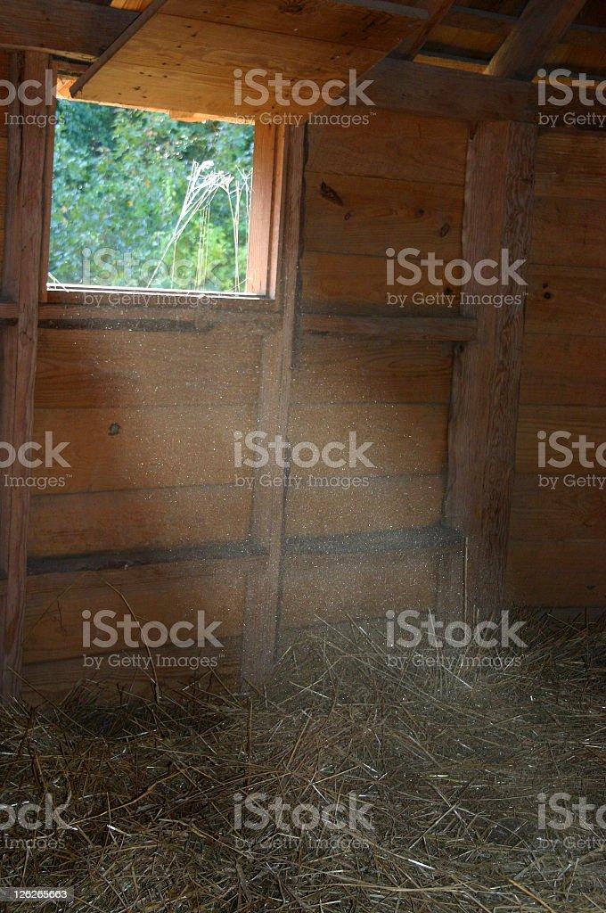 Beautiful sunbeam shining through window in stable/barn stock photo