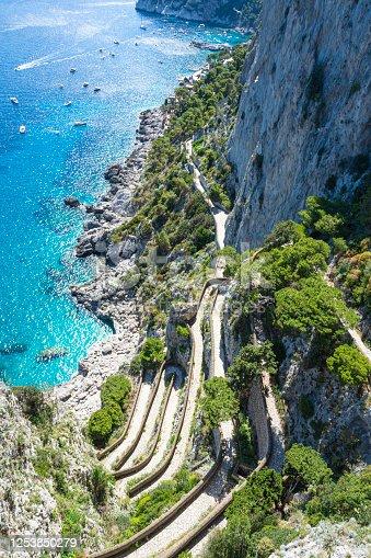 istock Beautiful sunny day at Via Krupp, on the coast of Mediterranean Sea - Capri Island ,Italy. 1253850279