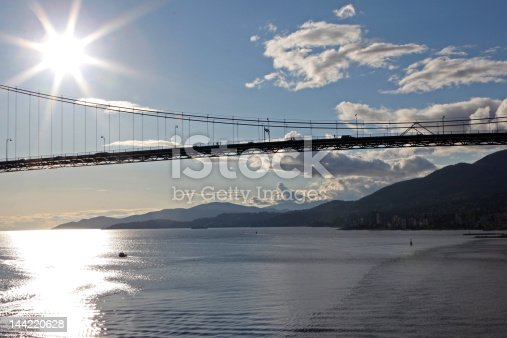 Approaching the Lions Gate Bridge, Vancouver B.C. as the sun rises.