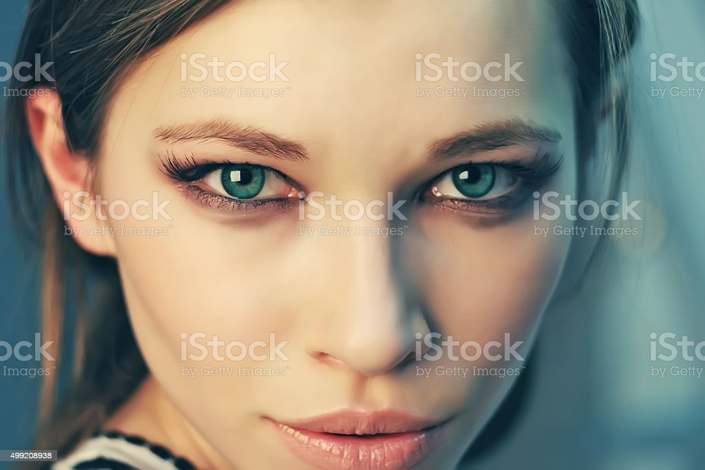 Beautiful sunny portrait of a girl with green eyes stock photo
